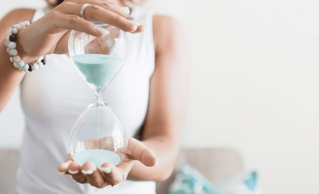 Save Time Hacks woman holding hourglass